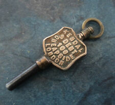 Advertising Pocket Watch Key - Kendal & Dent of 106 Cheapside  London  -  no. 8