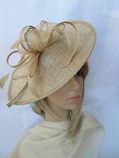 Pale Gold Feather fascinator on a headband..Shaped saucer disc,Wedding.races