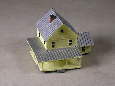 Z Scale Yellow Farm House with many porches.