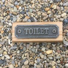 cast iron toilet sign on wood plaque handmade
