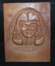 wood plaque with hand carved face