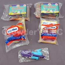 Lot of 4 Burger King Toys: 2 Craniums 2 Little Tikes plus Monsters Inc Sully