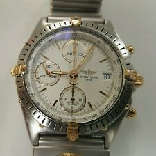 Breitling Chronomat B13048 with bullet UTC bracelet in 18k and stainless steel.