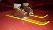 A Pair of Vintage Mini Skis and  Snow Boots Made In Austria
