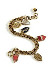 Juicy Couture YJRU5907 Lovely Gold Assembled Shield Charm  Bracelet New In Box