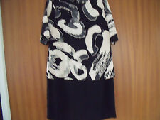 WAREHOUSE BLACK AND CREAM PRINT DRESS. SIZE 10.