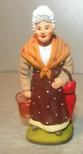 NEW The woman with a foot warmer, 7 cm Santons Didier from France
