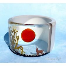 MINIATURE DEER CLEAR WINDOWS BANGLE BRACELET DESIGNED BY OKSANA BELL.