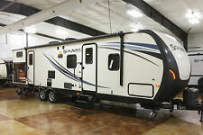 New 2015 Palomino Solaire 317BHSK Travel Trailer with Bunks and Outdoor Kitchen