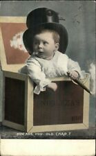 Baby Boy in Box Wearing Top Hat Smoking Cigar c1910 Postcard