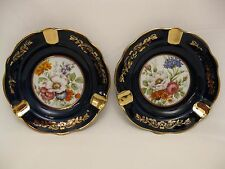 Limoges Garanti or Veritable Cobalt blue floral ashtrays.