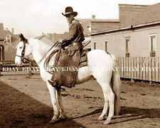 PHOTO OF COWBOY WEARING GAMBLER'S CHAPS IN THE OLD WEST