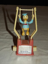 VINTAGE TOY WALT DISNEY DONALD DUCK  TRICKY TRAPEZE PUSH BUTTON  ACROBAT TOY