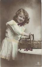 BEAUTIFUL YOUNG GIRL HOLDING A BUNCH OF CHERRYS IN HER MOUTH  VINTAGE POSTCARD