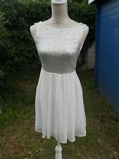 T. F. N. C short dress size S top silver covered in circle sequins bottom cream