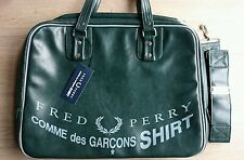 Green sports bag by Comme des Garçons for Fred Perry