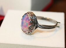 Pink Mexican Fire Opal ring ringed in leaves and spirals. Sterling Silver (925)