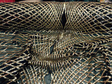 Diamond design mesh fabric lace gold & black. Sold by the yard.
