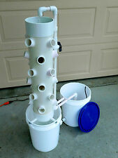 Hydroponic tower with 24 grow pods, two 5 gal gallon pails and visual fountain.