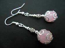 A PAIR OF DANGLY PINK JADE BEAD  SILVER PLATED DROP EARRINGS.
