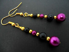 A PAIR OF DANGLY PURPLE & BLACK GLASS PEARL  GOLD PLATED EARRINGS.