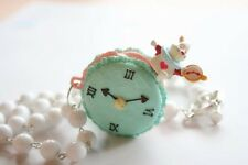 Alice in Wonderland Rabbit sitting on a macaroon necklace