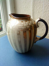Large milk jug with gilded decoration in brown earthenware 15.7cm tall