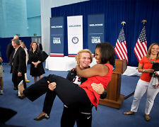 FIRST LADY MICHELLE OBAMA PICKED UP BY U.S. OLYMPIC WRESTLER 8X10 PHOTO (DD-090)
