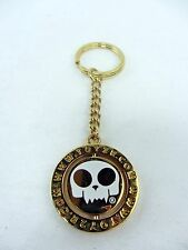 "Toy2R Gold Metal Keychain Toyer head logo Middle metal coin spins 1.25"" diameter"