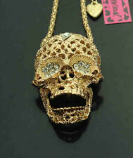 H665G     Betsey Johnson Gold Tone w/Crystal Movable Jaw Skull Pendant Necklace