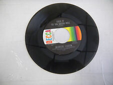 MARION WORTH he's mean to me / sock it to em sister nell DECCA    45