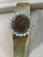 VINTAGE LADIES BULOVA DIOR, 14K  GOLD CASE AND STRAP WITH DIAMONDS.