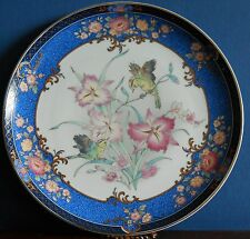 A 10.5 inch porcelain decorative plate depicting flowers and birds