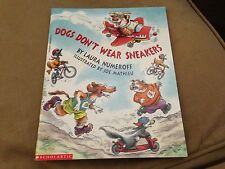 Dogs don't wear snikers  Children book by LAURA  NUMEROFF  (paperbacks)