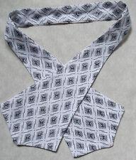Pussy bow tie vintage 1980s punk femme self cravate noir blanc à motifs