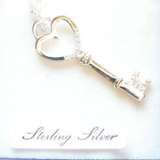 STERLING SILVER STONE SET KEY TO MY HEART PENDANT.  KEY PENDANT MADE OF SILVER