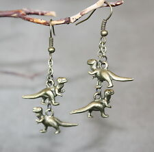 Dinosaur earrings Jurassic Park comes alive dangling dinosaurs held by chains