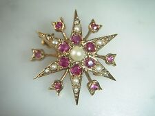 A BEAUTIFUL RUBY AND CULTURED  PEARL STAR BURST 9 CT GOLD  BROOCH