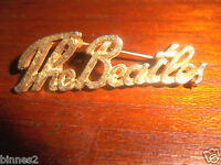 "THE BEATLES GENUINE 1960's BROOCH-BADGE-PIN GOLD COLOUR SCRIPT ""THE BEATLES"" ACE"