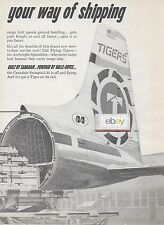 FLYING TIGERS LINE CL-44 IS OFF AND FLYING GOT A TIGER ON TAIL 2 PG 1962 AD