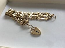 "9ct Gold 6.5"" gate bracelet with padlock"