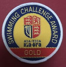 BRAND NEW  Kia-Ora ASA / ESSA SWIMMING CHALLENGE AWARD GOLD CLOTH PATCH SEW ON