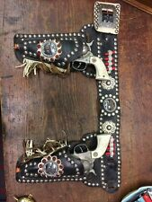 Set Of 2 Cast Vintage Cowboy Cap Guns With A Double Leather Holster.