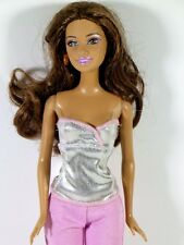 DRESSED BARBIE DOLL IN SILVER TANK TOP AND PASTEL PANTS
