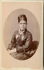 c1880-1889 Welsh Woman with Braided Hair, Cross Expression, Elegant Dress