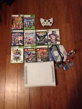 X-box 360 with 11 games and wireless controller bundle.