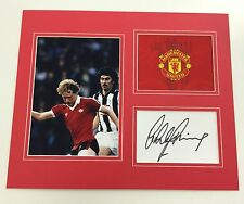 A 12 x 10 inch mounted display signed by Ashley Grimes of  Manchester United.