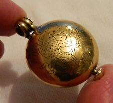 Vintage antique gilt metal and steel Christian secret keepsake locket.
