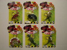 RARE JURASSIC PARK THE LOST WORLD 1996 COMPLETE SET OF DINO SKELETON KEYCHAIN
