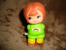 """Vintage 1979 Tomy Kid-A-Long Girl on roller skates White Knob Wind Up 3.5"""" tall"""